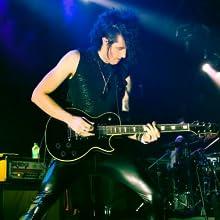 rockstar in black wet look faux leather mens leggings on stage in meggings