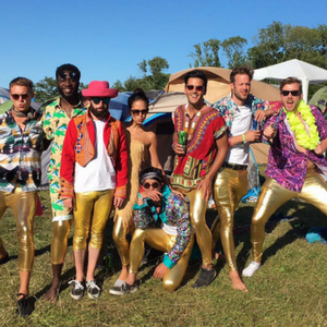 group of people at festival wearing gold metallic shiny mens leggings