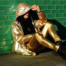 man sitting in gold metallic faux leather mens leggings