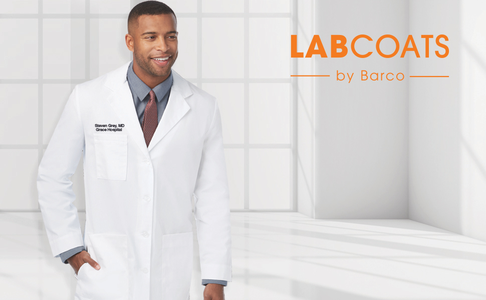 A medical doctor smiling while wearing Barco Uniforms Lab Coats
