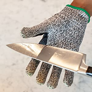 Image of a Bison Life Safe Handler cut resistant glove with a sharp knife