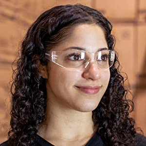 Image of woman wearing clear safety glasses in a warehouse.