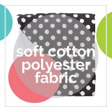 A black blanket with white polka-dots by Baby Elephant Ears with text: soft cotton polyester fabric.