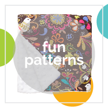 A Baby Elephant Ears blanket with a Birds of Norway pattern with text: fun patterns.