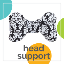 "Baby neck support pillow with a woodland creature design with text ""head support."""