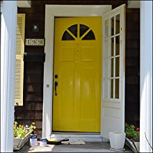 Customer the front door of her home with high gloss TotalBoat Wet Edge Yellow topside paint