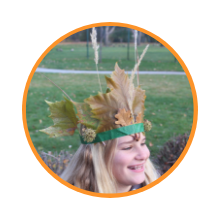 girl wearing headband made with masking tape, leaves and grasses