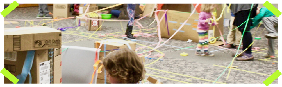 kids spreading tape everywhere in a large room