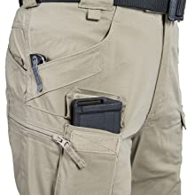 Cargo pockets, velcro closed pockets and side pockets. Reinforced edge for pocket knifes