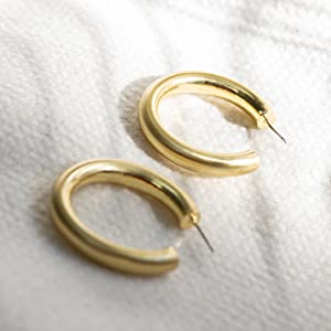 pair of hoop earrings in sunlight