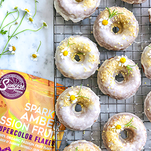Passion Fruit Donuts with Sparkly Amber Passion Fruit Supercolor Flakes topped