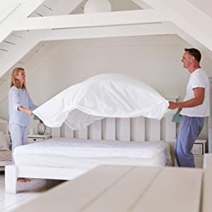 Twopeople making their bed