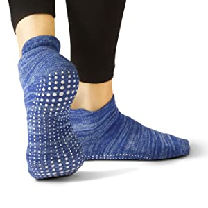 Covered blue sock close up on female foot revealing custom grip pattern