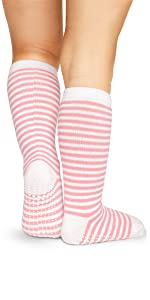 model in pink knee high striped fun colors sock with max traction non skid anti slip soles