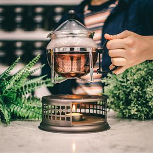 GROSCHE nairobi teapot warmer placing teapot  onto warmer