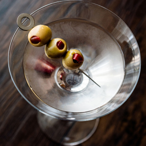 Up Close of Martini and Olives