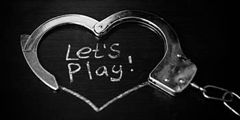handcuffs with writing that reads let's play