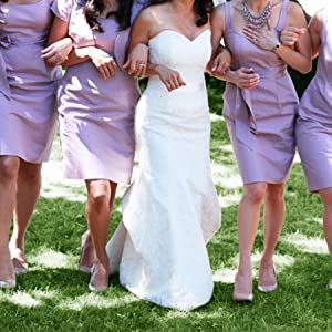 Bride and bridesmaid walking on grass with GoGoHeel Stoppers