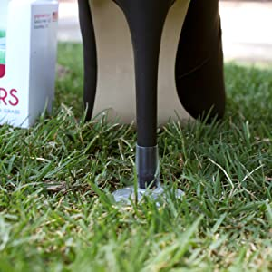 GoGoHeel STOPPERS Heel Protector on black high heels in grass